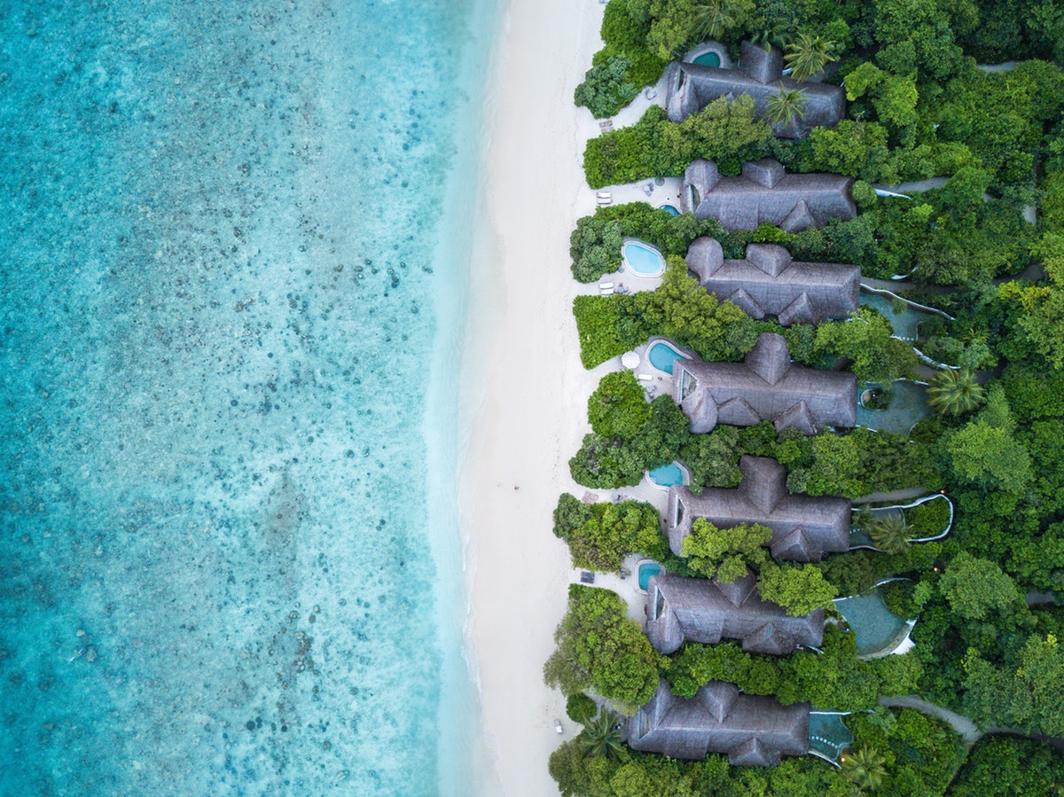 Soneva-Fushi-Family-Villa-Suite-with-Pool_Aerial-by-George-Rishaan