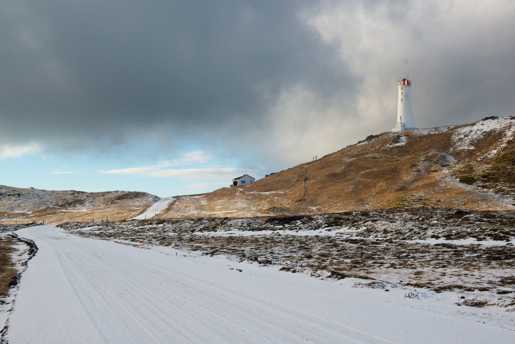 Lighthouse near geothermal area Gunnuhver at winter, Reykjanes Peninsula, Iceland