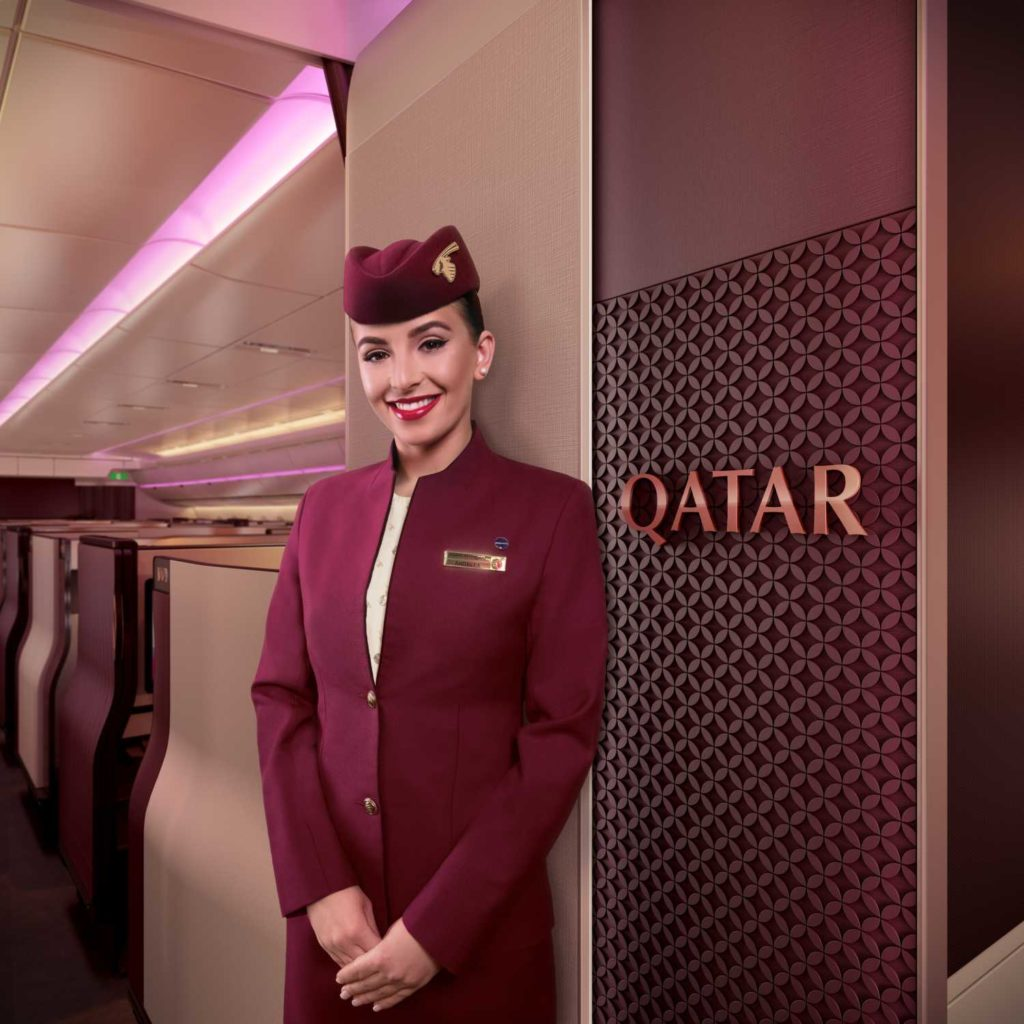 Qatar-Airways-Qsuite-business-class - Lady-welcoming-in-Business-Class.jpeg
